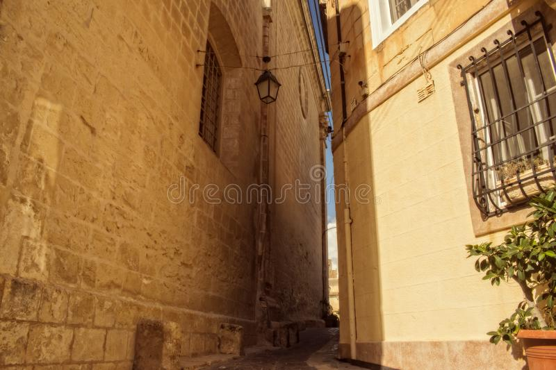 Old Narrow Street in Attard, Malta. A typical Old Narrow Street with limestone walls in Attard, Malta stock image