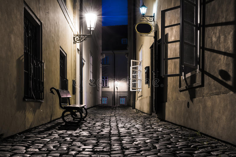 Old narrow street in Prague at night stock images