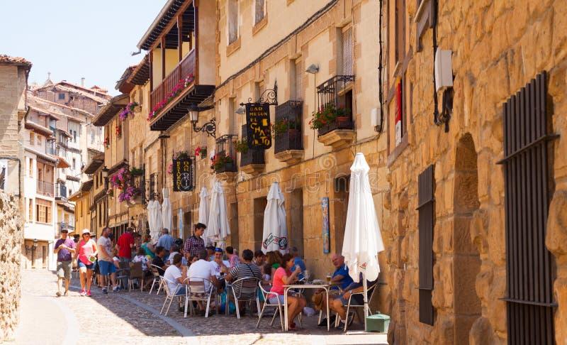 Old narrow street with restorain in Frias. Burgos royalty free stock photo