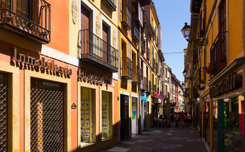 Old narrow street with stores in Leon royalty free stock photos
