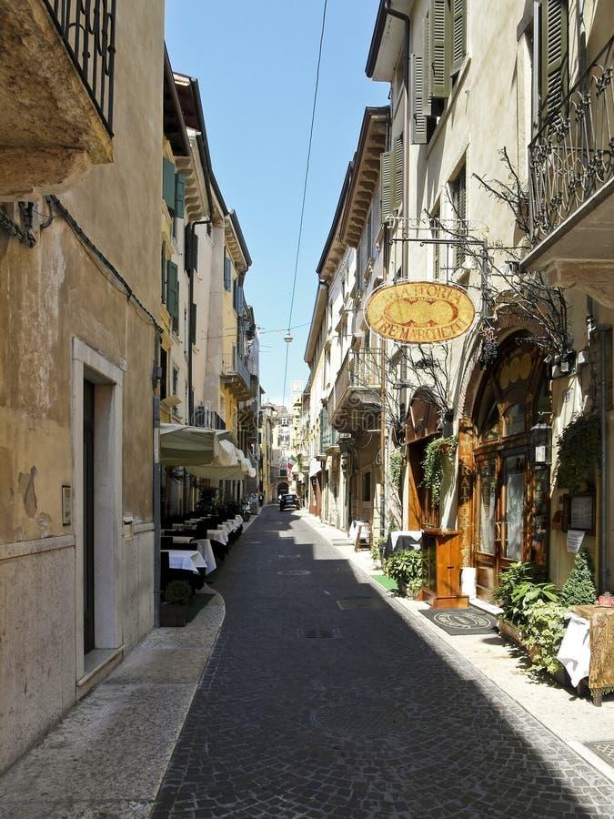 Old narrow street, Verona, Italy stock photo