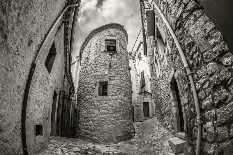 Old narrow street view of medieval Girona. Catalonia, northeastern Spain royalty free stock photography