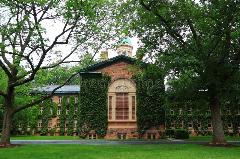 Old Nassau Hall Princeton University. Old Nassau Hall, the oldest building with ivy leave covered walls at Princeton University in Princeton, Mercer County, New royalty free stock image