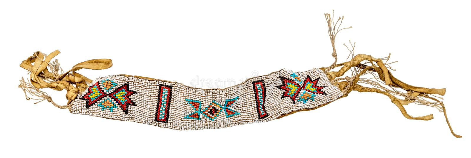 Old Native American bracelet sewn as jewelry / pearl weaving on leather royalty free stock images