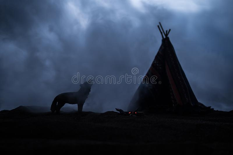 An old native american teepee in the desert stock photos