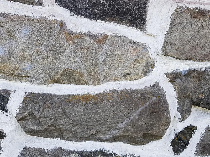 A natural stone wall background with white mortar. royalty free stock photo