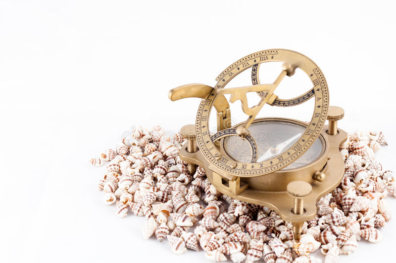 Old Nautical Sundial Compass With Shells Isolated Stock Image