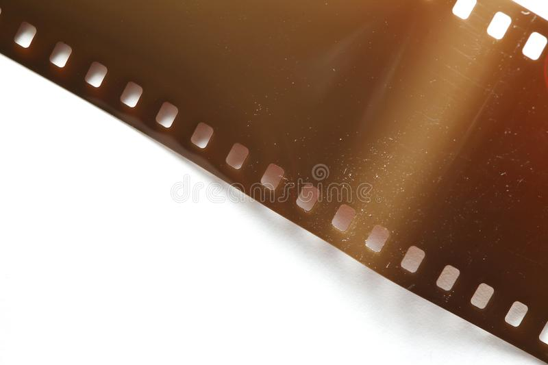 Old negative filmstrip. The old and dirty negative filmstrip represent the photography and camera support equipment concept related idea stock photos
