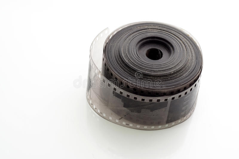 Old negative 35 mm film strip on white background. Strip of tangled movie film - place for copy and space text royalty free stock photo