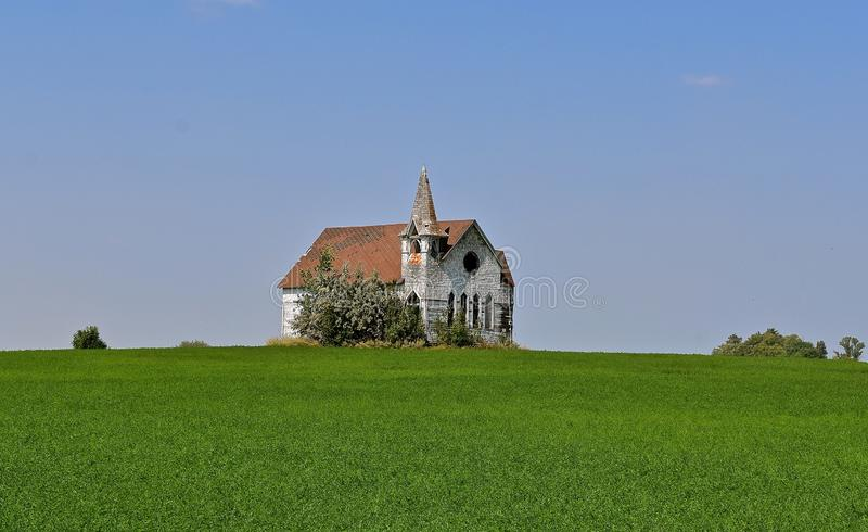 Old neglected white country church royalty free stock photo