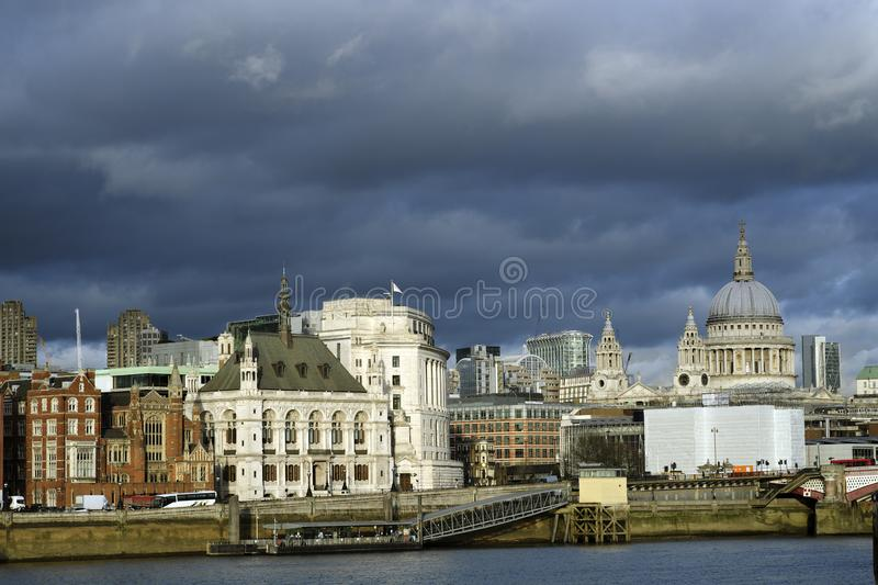 Old and new buildings against blue sky in uk stock photography