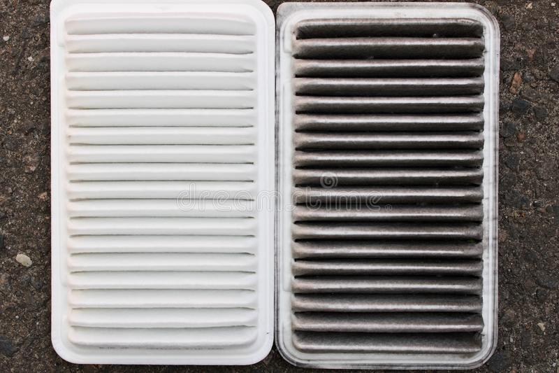 Old and new car air filter. Close up royalty free stock image