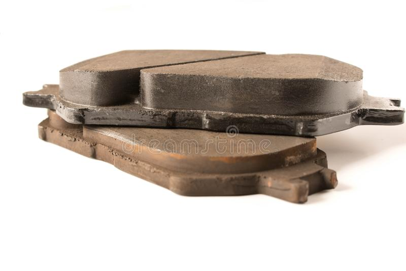 Old and new car brake pads. Auto parts. Security concept.  royalty free stock photos