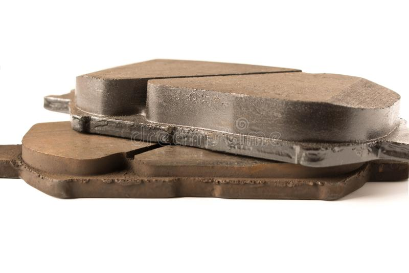 Old and new car brake pads. Auto parts. Security concept royalty free stock photos