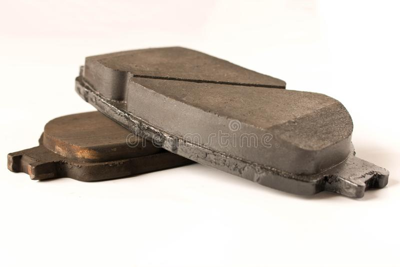 Old and new car brake pads. Auto parts. Security concept.  stock images