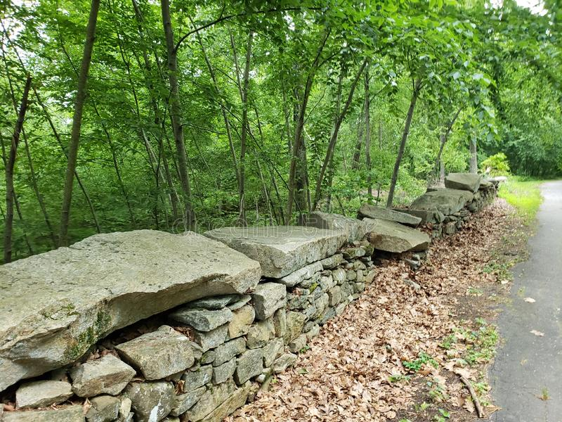 Old New England Stone Wall. Connecticut usa. , , , , , a     at the  with   of the  on the  and     a   . Foliage, slabs, lush, lushtrees stock images