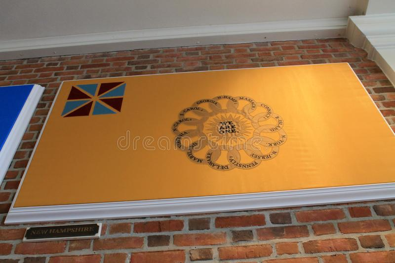 Old New Hampshire flag mounted on wall, Epcot. Second New Hampshire Regiment, continental flag mounted on American restaurant brick wall. Epcot International stock photo