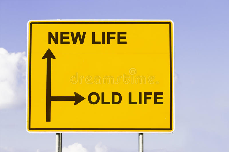 Old new life. Yellow traffic sign with arrows in two directions. One arrow shows the way to new life, the other the way to old life, concept for making a change royalty free stock photo