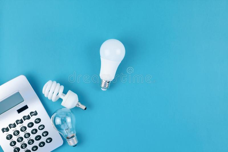 Old and new light bulbs. Energy saving concept. Energy and money saving and eco-friendly life in conceptual composition. Creative top view flat lay of new and stock photo