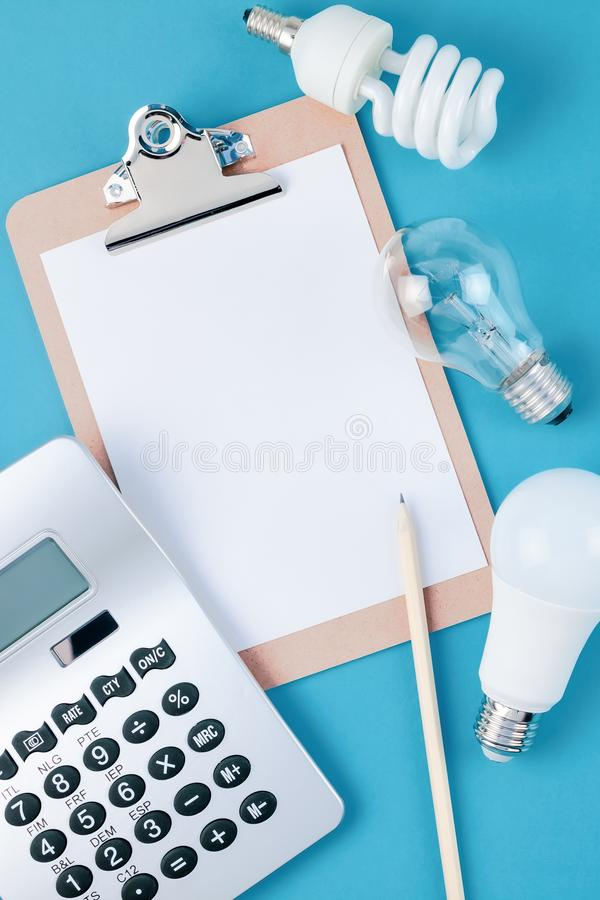 Old and new light bulbs. Energy saving concept. Energy and money saving and eco-friendly life in conceptual composition. Creative top view flat lay of new and stock photos