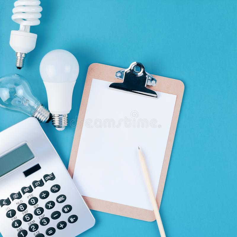 Old and new light bulbs. Energy saving concept. Energy and money saving and eco-friendly life in conceptual composition. Creative top view flat lay of new and royalty free stock photo