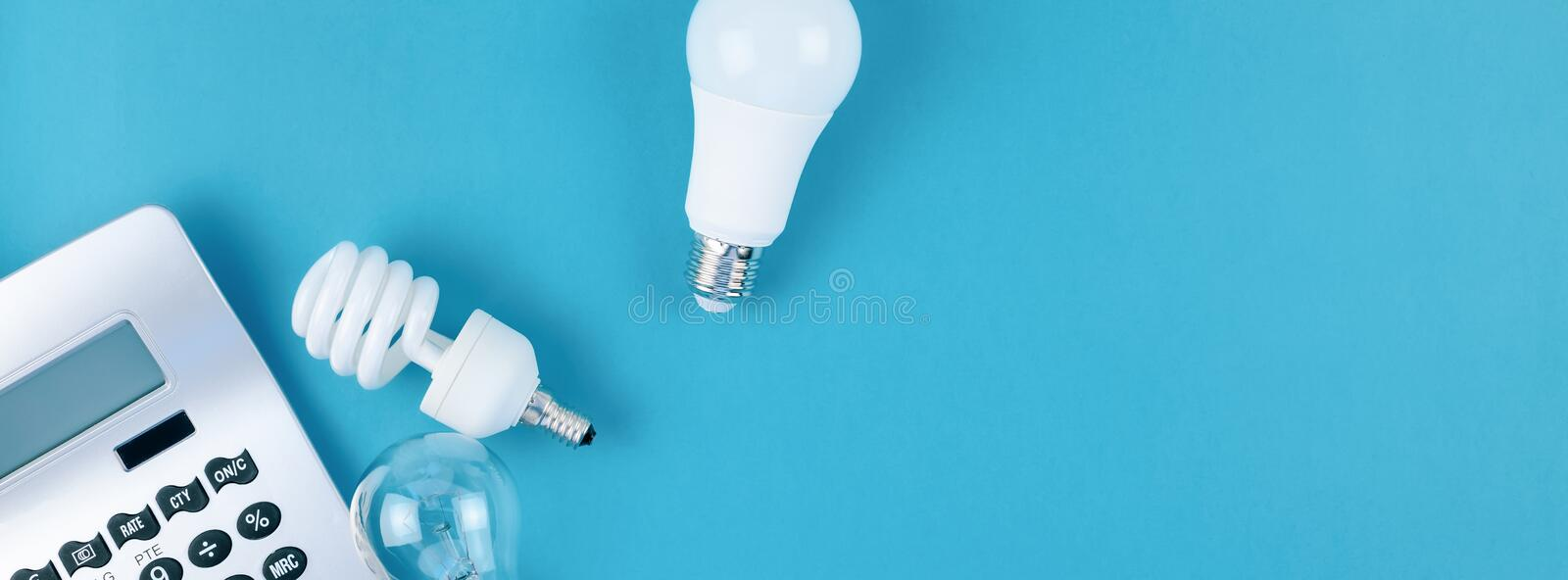 Old and new light bulbs. Energy saving concept. Energy and money saving and eco-friendly life in conceptual composition. Creative top view flat lay of new and stock images
