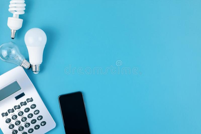 Old and new light bulbs. Energy saving concept. Energy and money saving and eco-friendly life in conceptual composition. Creative top view flat lay of new and royalty free stock images