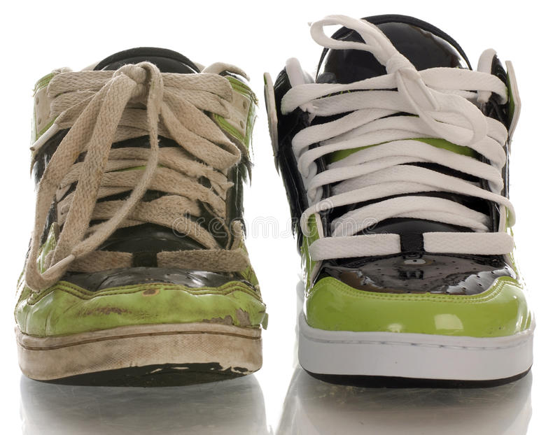 Old and new running shoe. One new shoe and one worn out shoe royalty free stock image