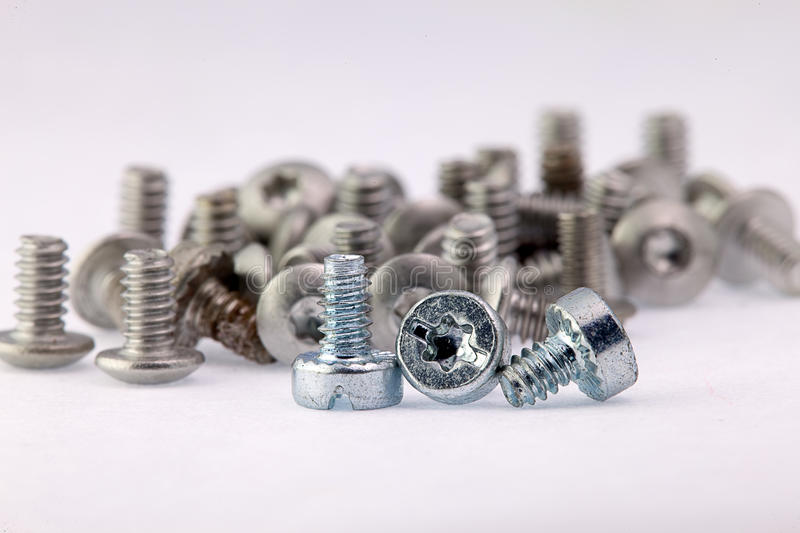 Old and new screws. New employees and old employees, mean work together, both of them are very important royalty free stock images
