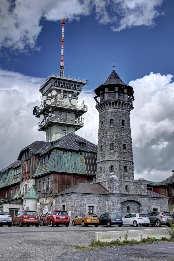 Old and new towers. Telecommunication tower by the historic outlook tower royalty free stock images