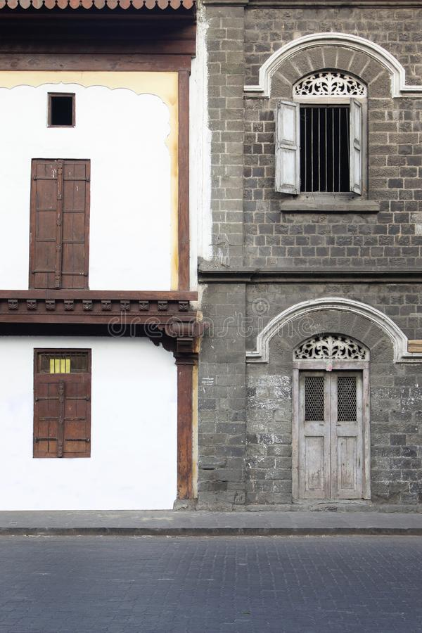 Old and new windows in contrast, Pune, Maharashtra, India.  royalty free stock images