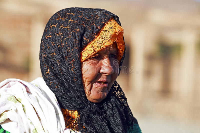 Old Nomad Woman In The Desert Editorial Stock Image