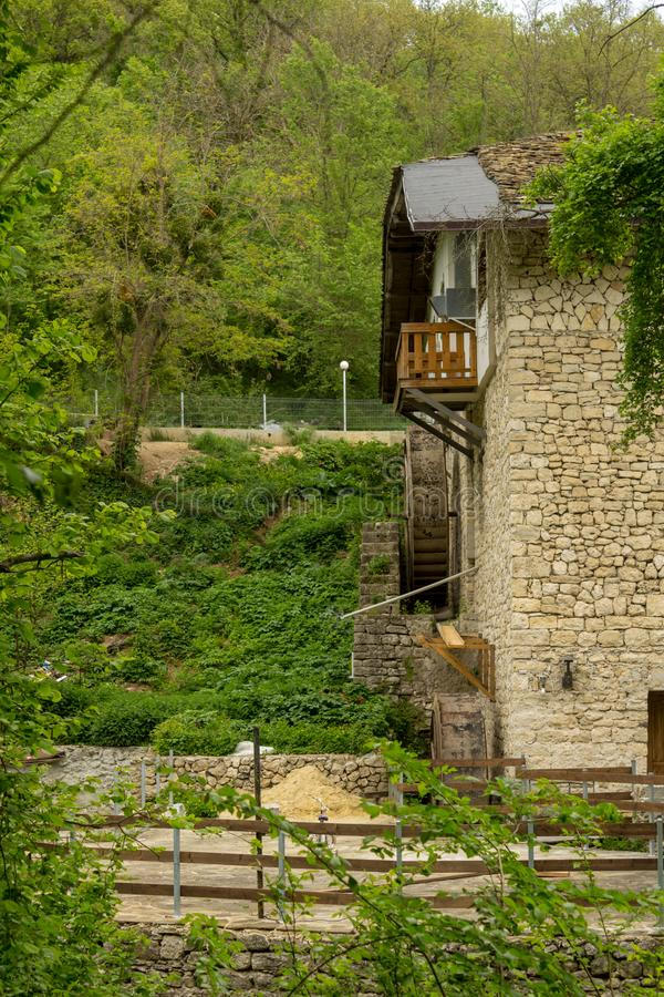 Old non working water mill in the forest in sunny day.  royalty free stock photos