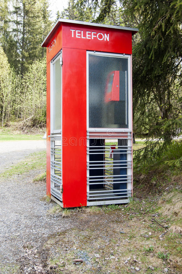 Old norwegian phone booth. Old red norwegian phone booth stock photo