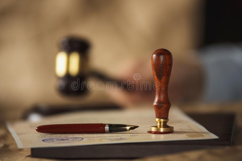 Old notarial wax seal and stamp on judicial table. Old notarial wax seal and stamp royalty free stock photography