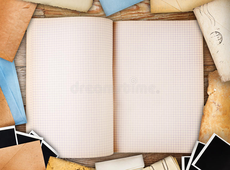 Old note book, paper and instant photos royalty free stock photo