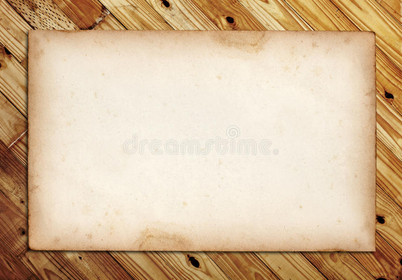 Old note paper on wood stock image