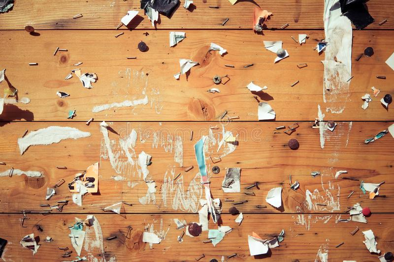 Old notice board with scraps of papers. Abstract detail stock photos