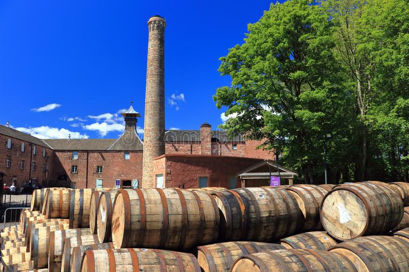 Old Oak Barrels in Front of Annandale Whiskey Distillery, Dumfries and Galloway, Scotland, Great Britain. Old oak barrels are stored outside the Annandale royalty free stock photos