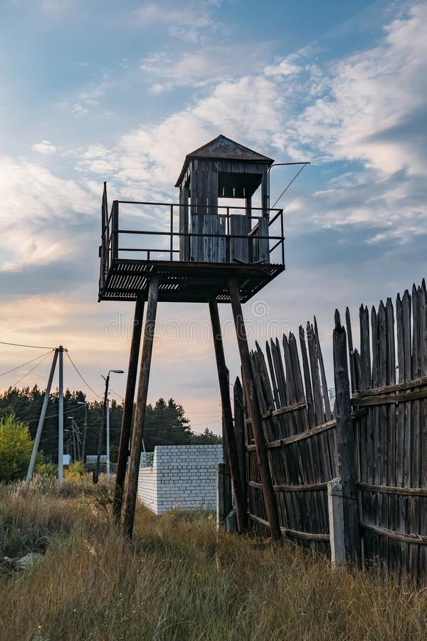Old observation tower in abandoned Soviet Russian prison complex royalty free stock photos