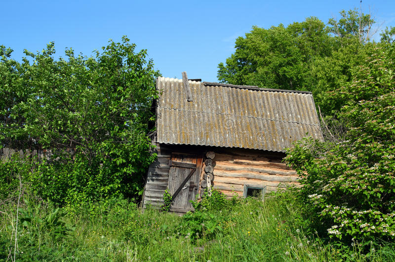 Download Old Obsolete Bath-house In Lush Foliage Royalty Free Stock Photo - Image: 12423895