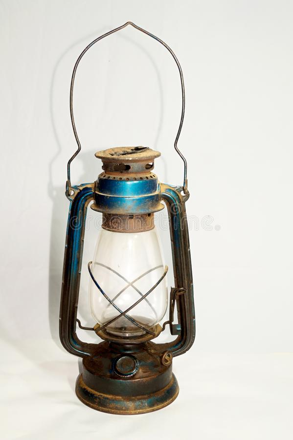 Old oil lantern is arranged on a white surface stock photo