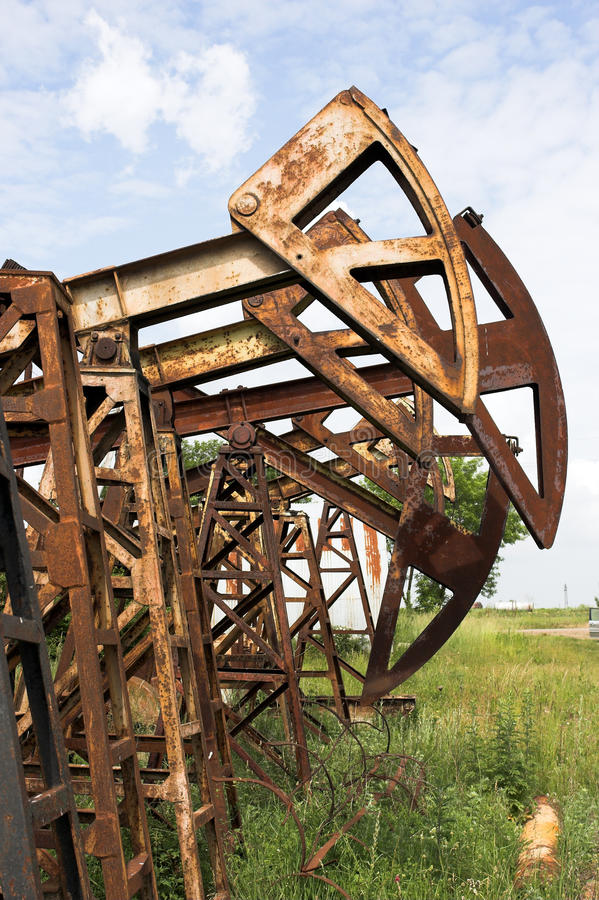 Old oil pump jack royalty free stock photos