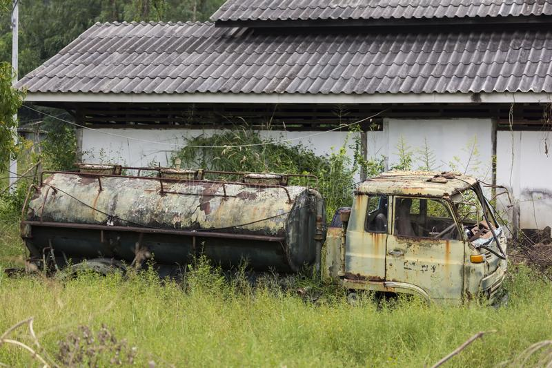 The old oil truck or tanker was left abandoned in the grass at the afterbirth.  royalty free stock photography