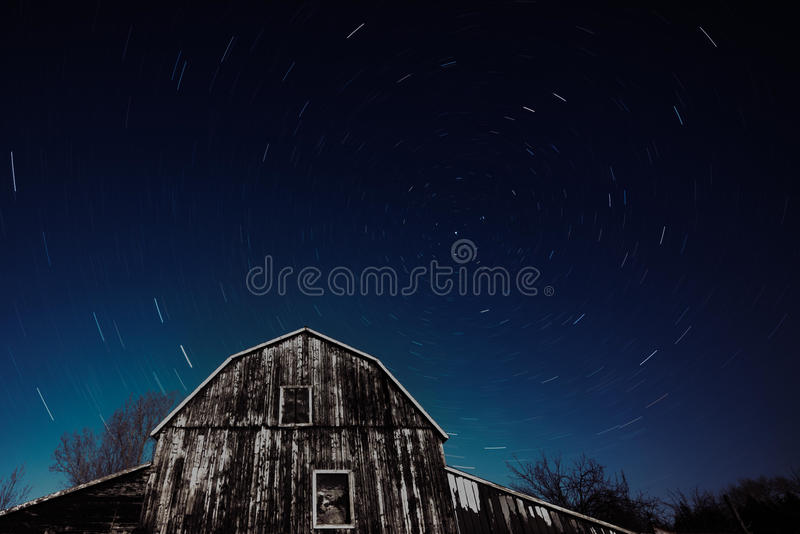 Old Ontario Barn and the night stars trailing stock image