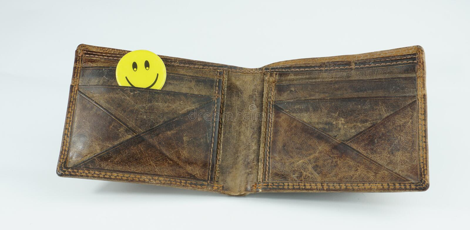 Old open Leather wallet with happy smiley face isolated on white background. Old open Leather wallet with energy saving bulb happy smiley face isolated on white stock image