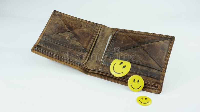 Old open Leather wallet with happy smiley faces isolated on white background. Finance and savings royalty free stock images