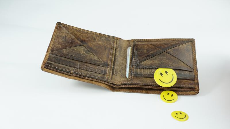 Old open Leather wallet with happy smiley faces isolated on white background. Old open Leather wallet with energy saving bulb happy smiley faces isolated on stock images