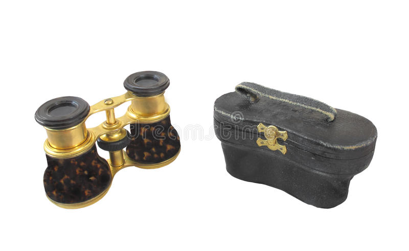Old opera glasses and case isolated. stock photography