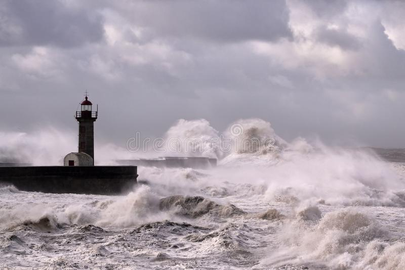 Lighthouse under heavy sea storm royalty free stock image